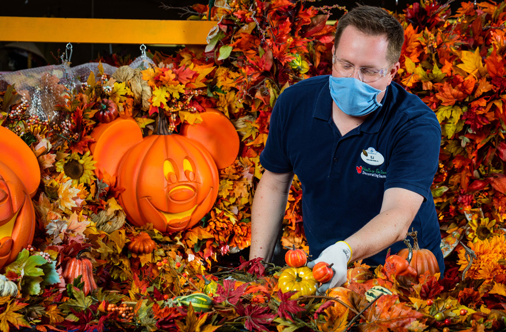 Cast member making fall decor